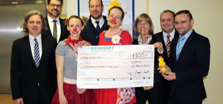 Firma Reinhart Immobilien Marketing spendet 1.500 € an die Lachtränen Würzburg