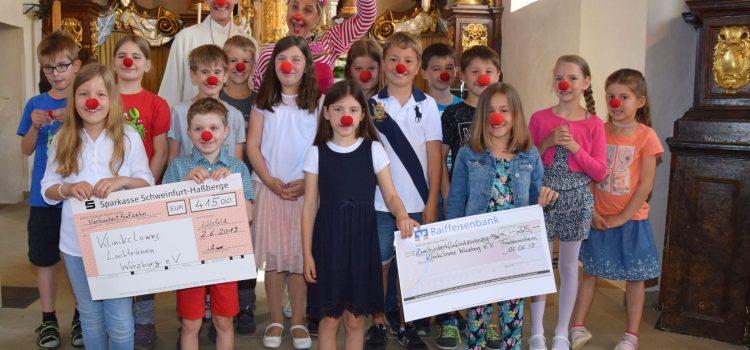 Spende der Kommunionkinder aus Lülsfeld, Schallfeld und Frankenwinheim an die Klinikclowns